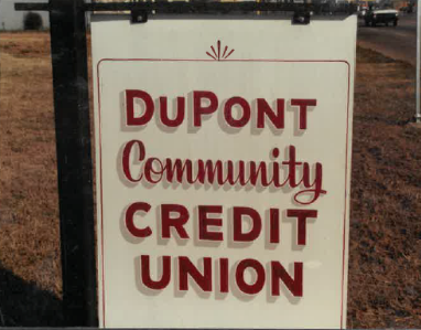 1986 signs says Dupont Community Credit Union.