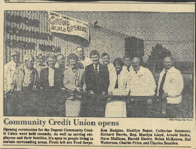"Newspaper article titled ""Community Credit Union opens"" with picture."