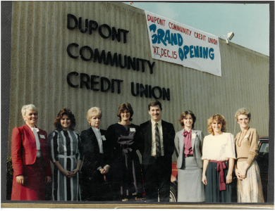 1986 photo of employees in front of the credit union's Hixson office grand opening.